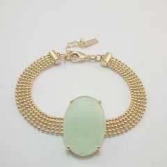 Pulseira com corrente malha fita e centro com cristal oval 18x25mm  verde leitoso