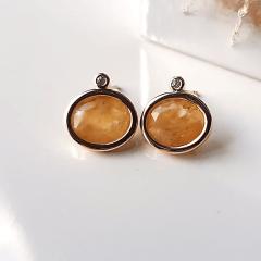 Brinco botão oval de cristal rutilo e zircônia 10x12mm