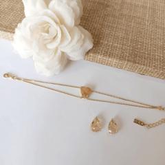 Conjunto pulseira e brinco de cristais rutilados com formato de coração